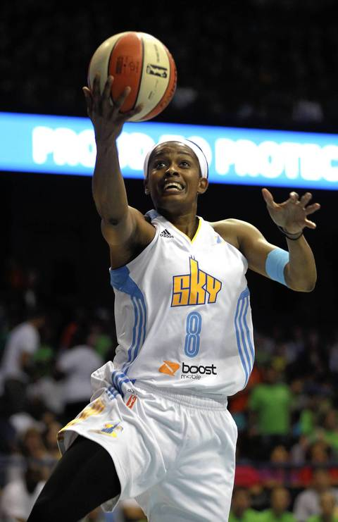 Sky guard Swin Cash drives the middle and scores.