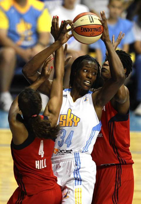 Sylvia Fowles grabs a rebound and looks for someone to pass to as Mystics defenders Tayler Hill and Michelle Snow surround her.