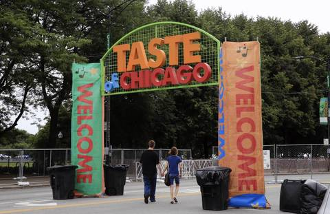 A couple walks through the entrance to the Taste of Chicago during set-up in Grant Park.