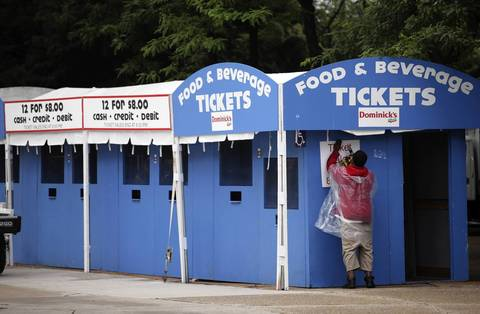 Finishing touches are added to a ticket booth.