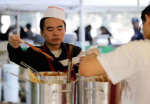 Workers prepare shrimp at Lao Ma La.
