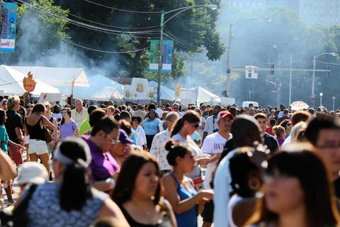Smoke rises from the food tents.