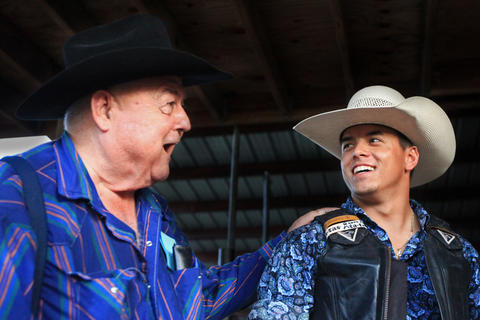 Gary Suhl, left, and Tyler West talk during the Kissimmee Sports Arena Rodeo on Saturday, July 13, 2013. Suhl opened the arena in 1992, and hosts rodeos twice a month. Suhl said he initially built the arena for his children to practice their events. (Megan May/Orlando Sentinel)