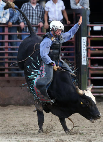Kailer Mccoy, 14, a junior bull rider, competes at the Kissimmee Sports Arena Rodeo on Saturday, July 13, 2013. (Megan May\Orlando Sentinel)