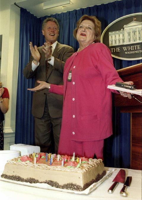 President Bill Clinton (L) applauds during a celebration of Helen Thomas' 75th birthday in the White House press room in Washington in 1995.