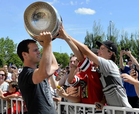 Fans reach for the Stanley Cup as Blackhawks captain Jonathan Toews brings the trophy to the community center named after him in his hometown of Winnipeg.