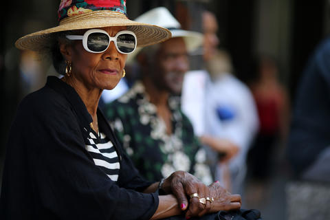 """Velda Erie listens during the """"Justice for Trayvon"""" vigil organized by National Action Network's Chicago Chapter Saturday, July 20, 2013 at the Dirksen Federal Building in Chicago."""