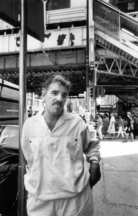 """Dennis Farina pictured by at the corner of Randolph and Wells in 1988. """"I've been very lucky, given the circumstances,"""" says Farina. """"When I first started out acting, I didn't have anything to lose. I had another career."""""""