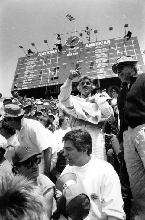 Joe Mantegna, foreground, and Dennis Farina, behind Mantegna, join other members of the cast of Bleacher Bums in the rightfield bleachers at Wrigley Field in 1989.
