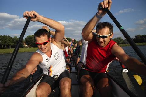 Cezary Miskiewicz, left, and Wojtek Wasilewski, both from Poland, dig water with their paddles during practice with Windy City Dragons teammates.