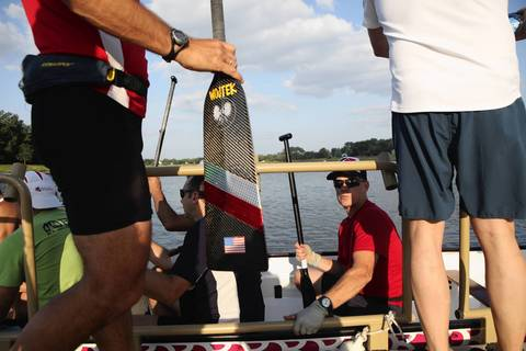 Mike Loosevelt, a member of Windy City Dragons, sits in the boat waiting for teammates to board before the dragon boating practice.