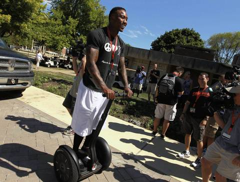 Wide receiver Brandon Marshall arrives in camp with a segway.