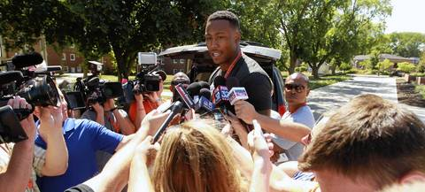 Wide receiver Brandon Marshall stands atop a segway as he talks to the media Wednesday.