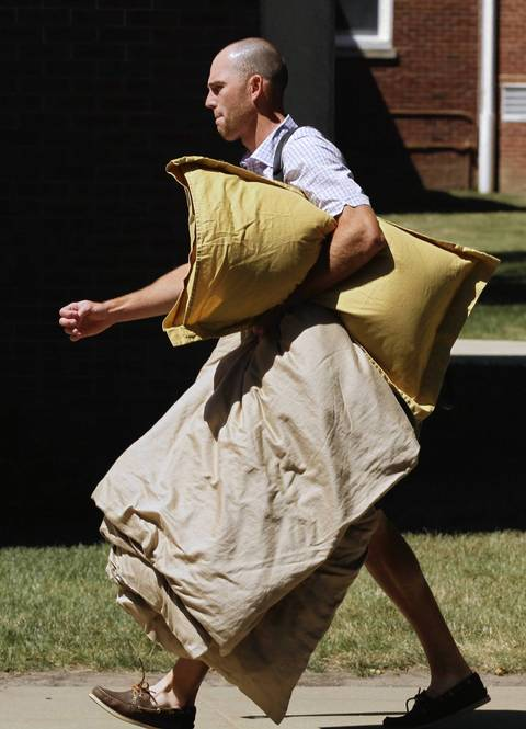 Kicker Robbie Gould arrives with pillows and bed linens Wednesday.