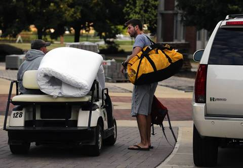 Bears quarterback Jay Cutler gets help with his belongings, after arriving for training camp.