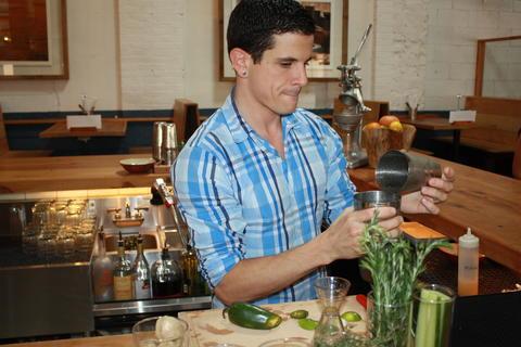 Bartender Chris McGowen prepares a jalapeno mango margarita.