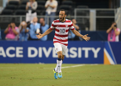 USA forward Landon Donovan (10) celebrates a goal in the first half against Honduras at Cowboys Stadium.