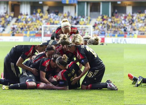 Germany's forward Dzsenifer Marozsan celebrates with her teammates after scoring past Sweden's goalkeeper Kristin Hammarstrom during the UEFA Women's European Championship Euro 2013 semi final football match Sweden vs Germany on July 24, 2013 in Gothenburg, Sweden.