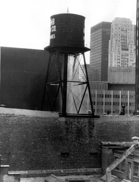 A water tank leaks atop Newcomb-Macklin Co. near State and Kinzie Streets in Chicago.