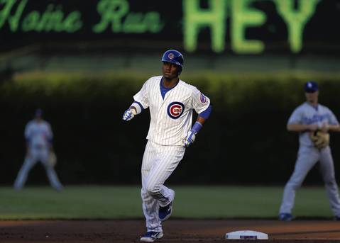 Left fielder Junior Lake rounds the bases after hitting his first home run at Wrigley Field in the first inning.