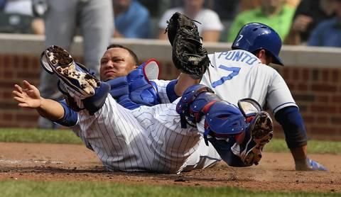 Cubs catcher Welington Castillo has just tagged out Dodgers runner Nick Punto on a delayed double steal in the third inning.