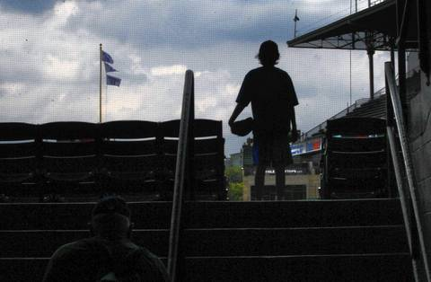 Glove in hand, a young fan watches batting practice Friday.