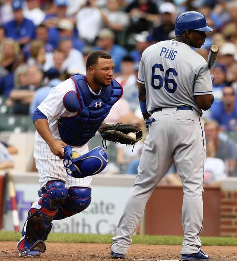 Cubs catcher Welington Castillo after Dodgers batter Yasiel Puig is out on a drop third strike to end the eighth inning.