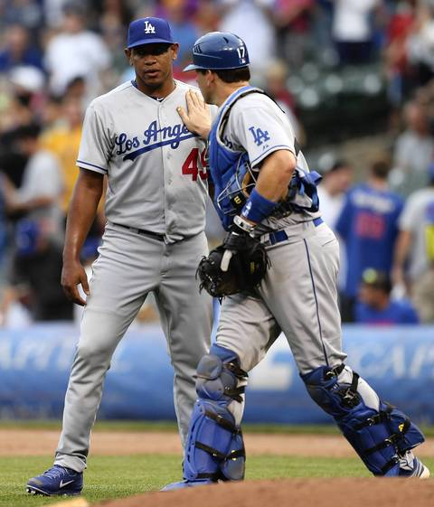 Dodgers catcher A.J. Ellis and closer Carlos Marmol after the last out and a Dodger win Friday.