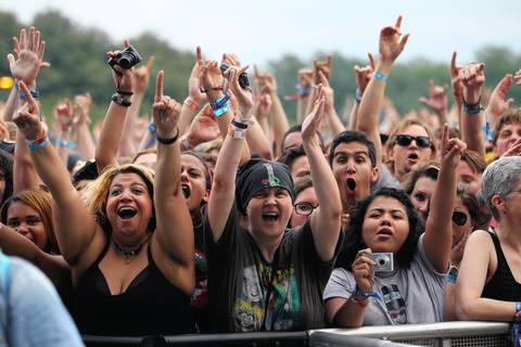 Fans react to Queens of the Stone Age at Lollapalooza on opening day in Chicago.