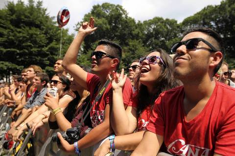 Lollapalooza concert goers cheer as San Cisco plays at the Grove stage on the first day of the three day music festival in Chicago.