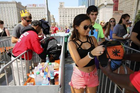 Abbey Hayes, 17, of Orland Park makes her way through security as Lollapalooza 2013 kicks off in Chicago's Grant Park.