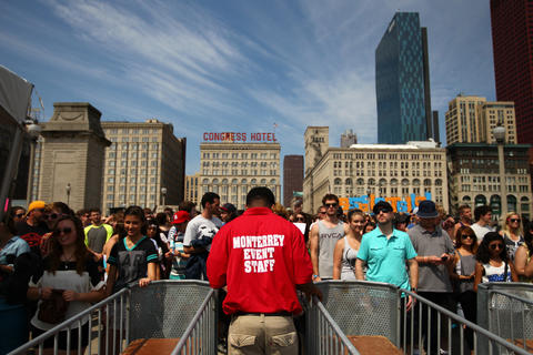 Lollapalooza concert goers await the opening of the South Michigan Avenue gate on Friday morning.