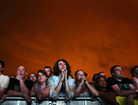 Fans watch Nine Inch Nails perform at Lollapalooza on Friday.