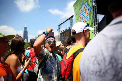 Paul Lee, of Los Angeles, sings along during the Robert DeLong performance at Lollapalooza in Chicago's Grant Park on Friday.