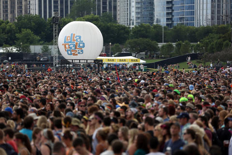 The crowd builds near the Lake Shore stage as Icona Pop performs at Lollapalooza in Chicago on Friday.