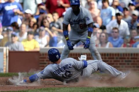 Dodgers baserunner Tim Federowicz slides in safely at home.