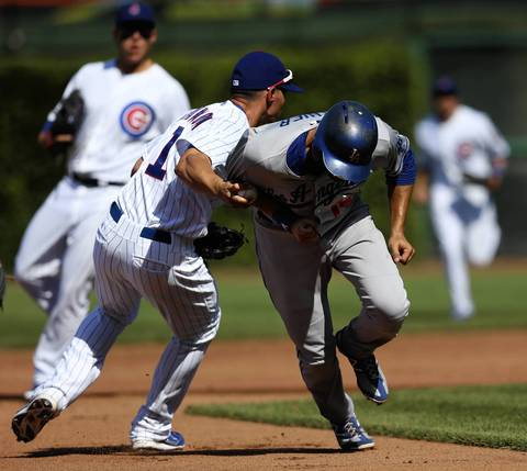 Cubs third baseman Cody Ransom tags out Dodgers baserunner Andre Ethier.