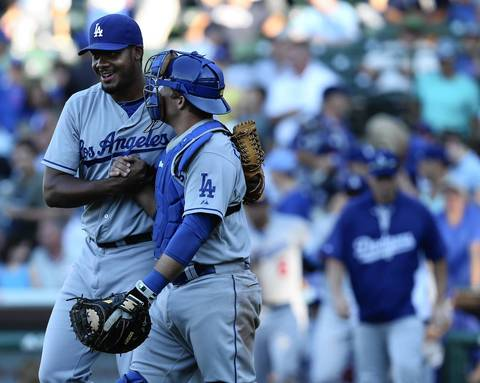 Dodgers relief pitcher Kenley Jansen and catcher Tim Federowicz celebrate their victory.