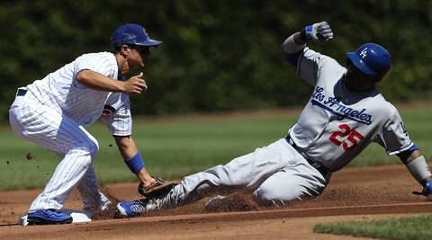 Carl Crawford is tagged out by Cubs second baseman Darwin Barney.