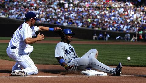 Cubs third baseman Cody Ransom is unable to field the ball as Dodgers baserunner Yasiel Puig advances to third.