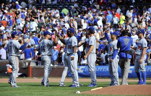 The Dodgers celebrate their 1-0 win over the Chicago Cubs.