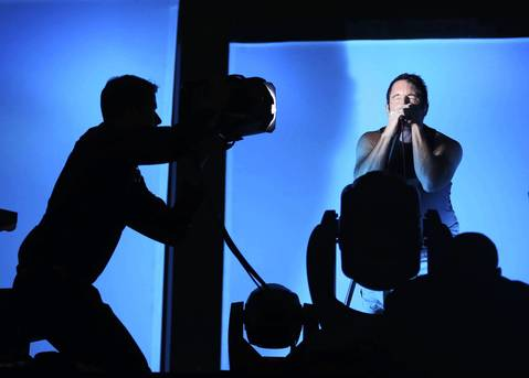 The Nine Inch Nails perform with the help of a lighting crew at Lollapalooza.