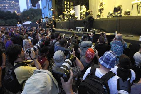 The photo pit holds some sixty photographers at the Nine Inch Nails performance at Lollapalooza.