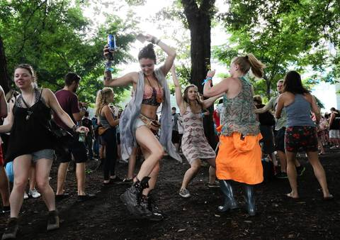 Fans dance to Disclosure, an English electronic music duo, on the first day of Lollapalooza in Chicago.
