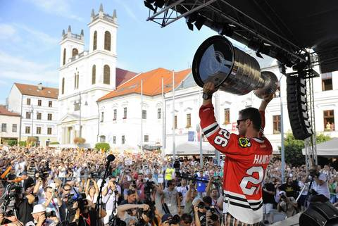 Michal Handzus holds the Stanley Cup as he arrives at main square in Banska Bystrica, Slovakia during a tour of his hometown.