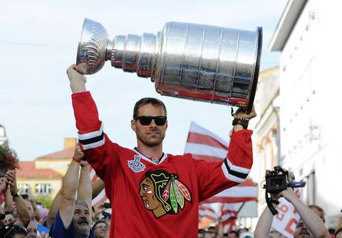 Michal Handzus holds the Stanley Cup as he arrives at main square in Banska Bystrica, Slovakia.