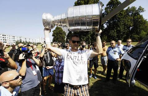 Michal Handzus hoists the Stanley Cup as he gets off a helicopter and arrives at Banska Bystrica, Slovakia.