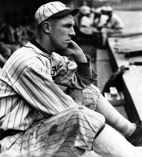 "Charles ""Swede"" Risberg watches the action from the White Sox dugout in 1920. A few weeks later, Risberg was indicted for his part in the Black Sox scandal. A shortstop of average skill, he was one of the leaders in the fix and, like the others, was banned for life despite being acquitted in court."