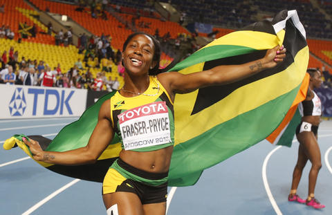 Shelly-Ann Fraser-Pryce of Jamaica celebrates winning the gold medal in the women's 100 metres final at the IAAF World Athletics Championships at the Luzhniki stadium in Moscow August 12, 2013.