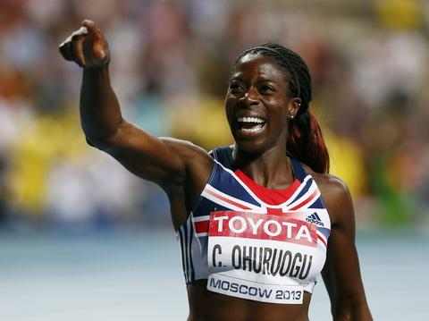 Christine Ohuruogu of Britain celebrates winning the women's 400 metres final during the IAAF World Athletics Championships at the Luzhniki stadium in Moscow August 12, 2013.